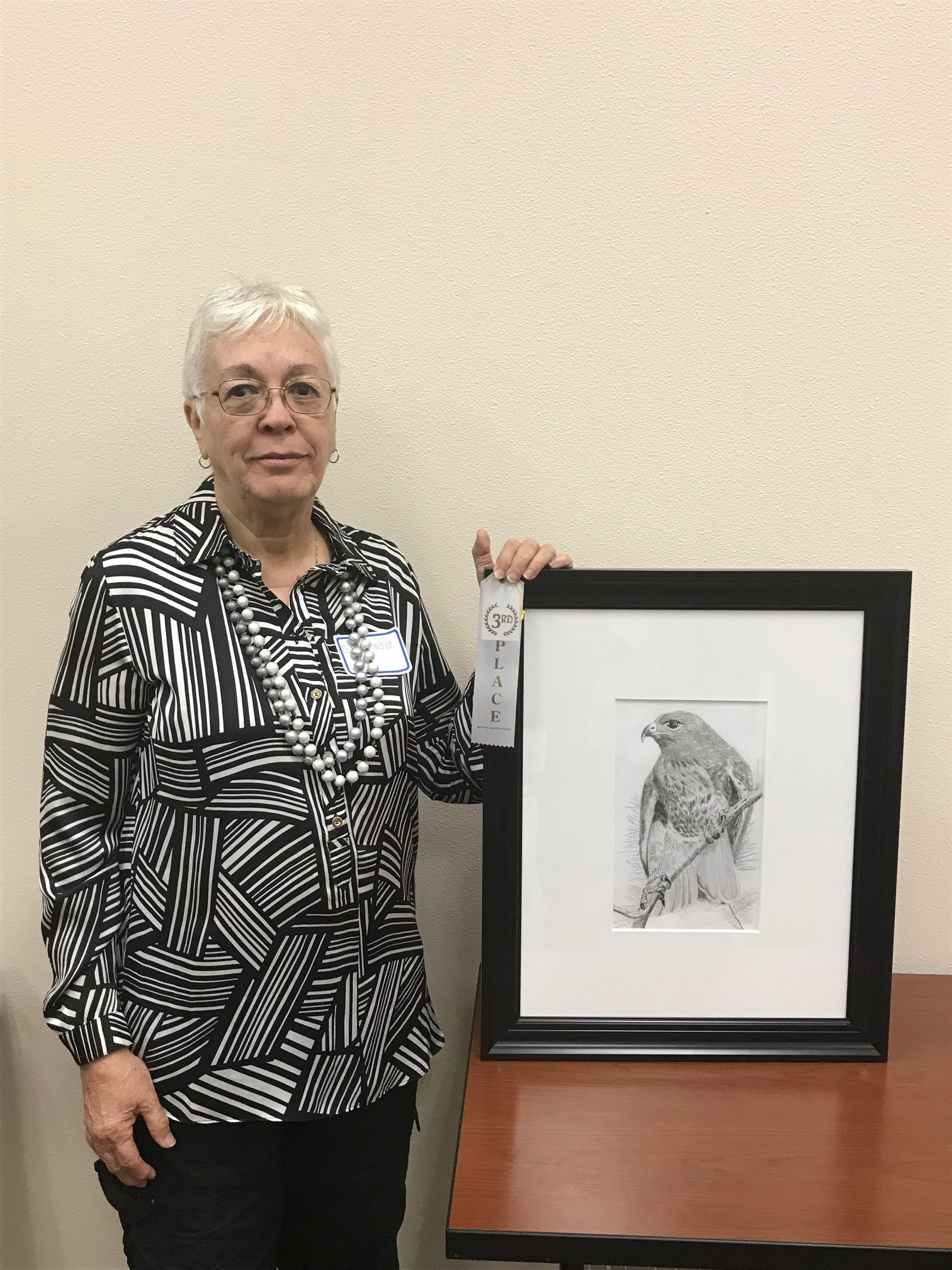 "Third Place: Lourdes Roberts    ""Incredible HawK""    Charcoal and Graphite    $250    817-244-9071    Displayed at Hilltop Bicycle Center, 130 N Main St, Mansfield, TX 76063"