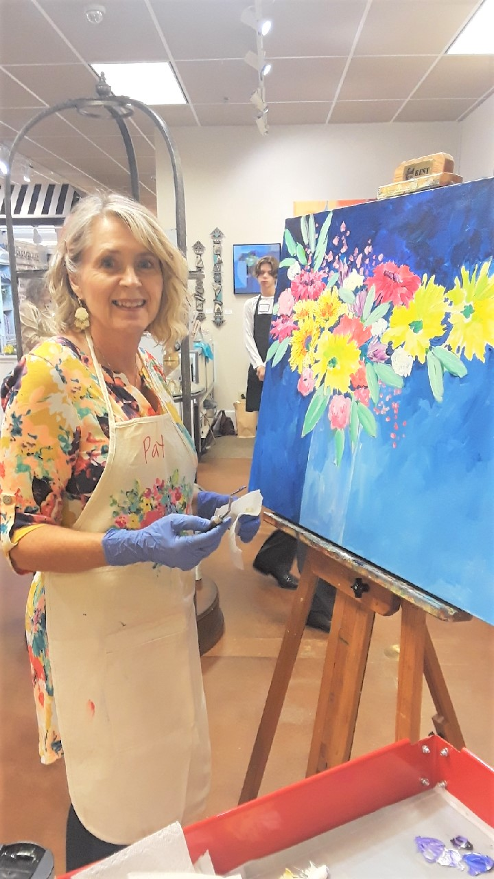 Patti Wilkinson, acrylic and oil artist, also did a live painting during the grand opening.