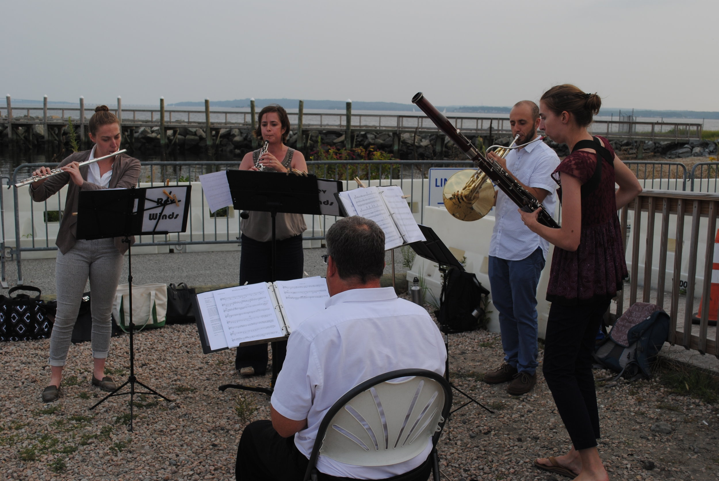 Revolution Winds performing on the shore after the boat tour