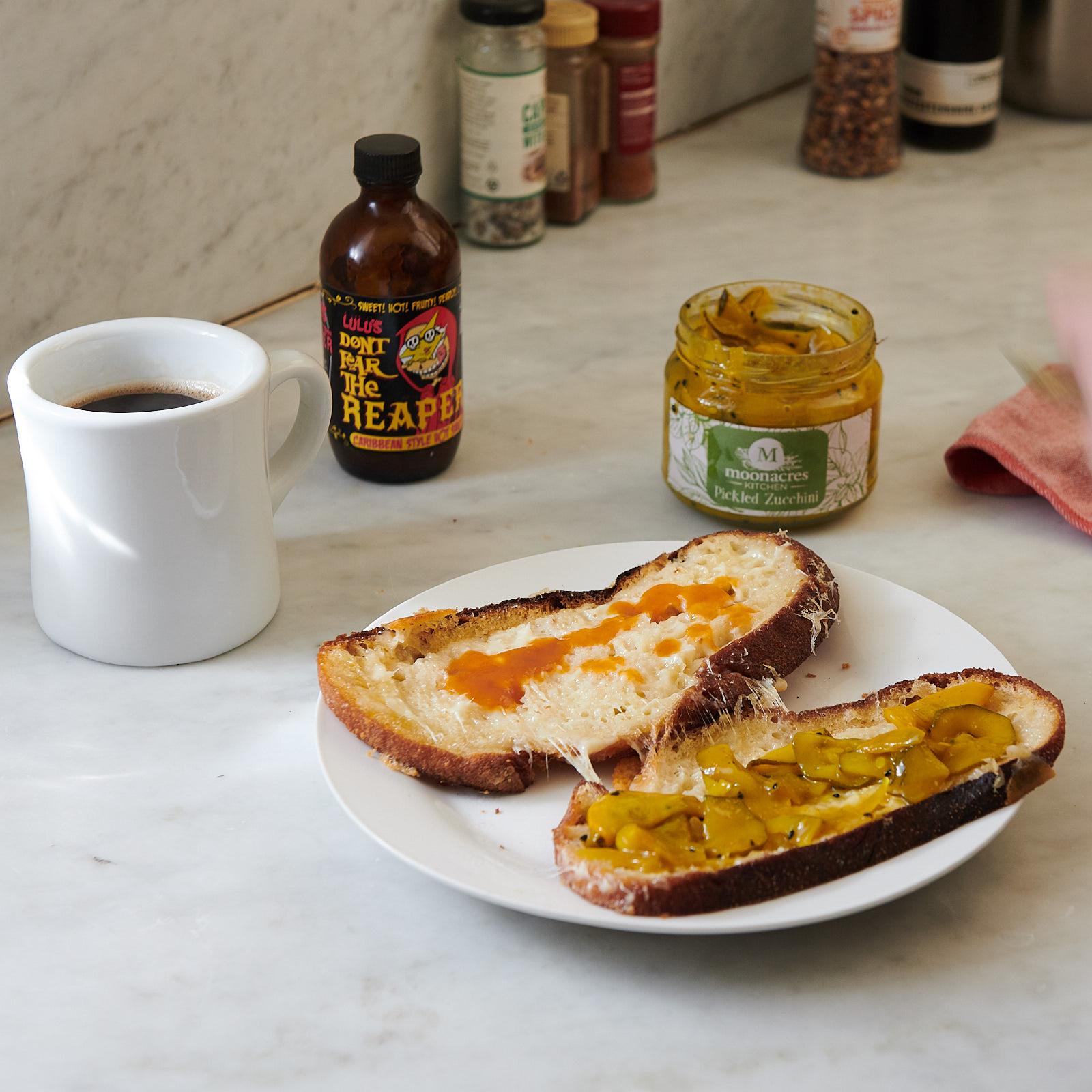 Sourdough, Heidi Farm Tilsit, Lulu's hot sauce and Moonacres Pickled Zucchini. Butter. Oil. Butter. Tick.