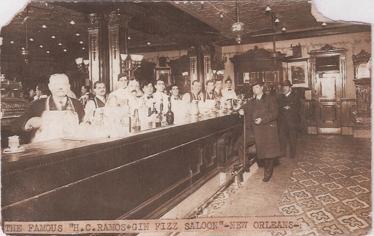 """The famous H.C.Ramos Gin Fizz Saloon - New Orleans"" - lots of barmen but, on this occasion, few customers!"