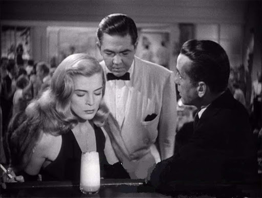 Lizabeth Scott and Humphrey Bogart (R) with a Ramos Gin Fizz in DEAD RECKONING (1947)