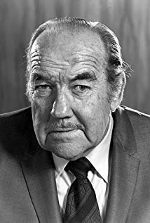 Broderick Crawford. That face looks like he's downed more than a few.