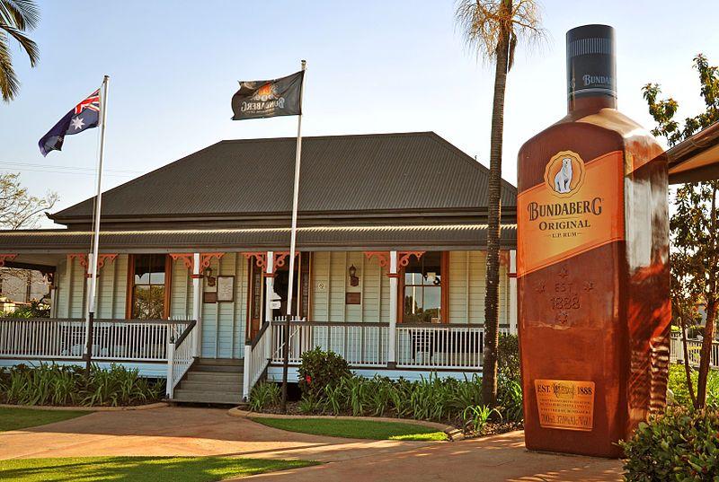The old Bundaberg Distillery Visitors Centre & a 'Big Bundy' bottle'