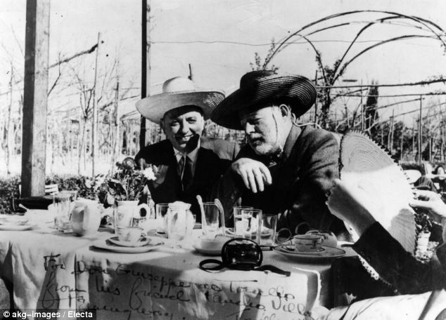 Ernest Hemingway, right, pictured with the bar's founder Giuseppe Cipriani