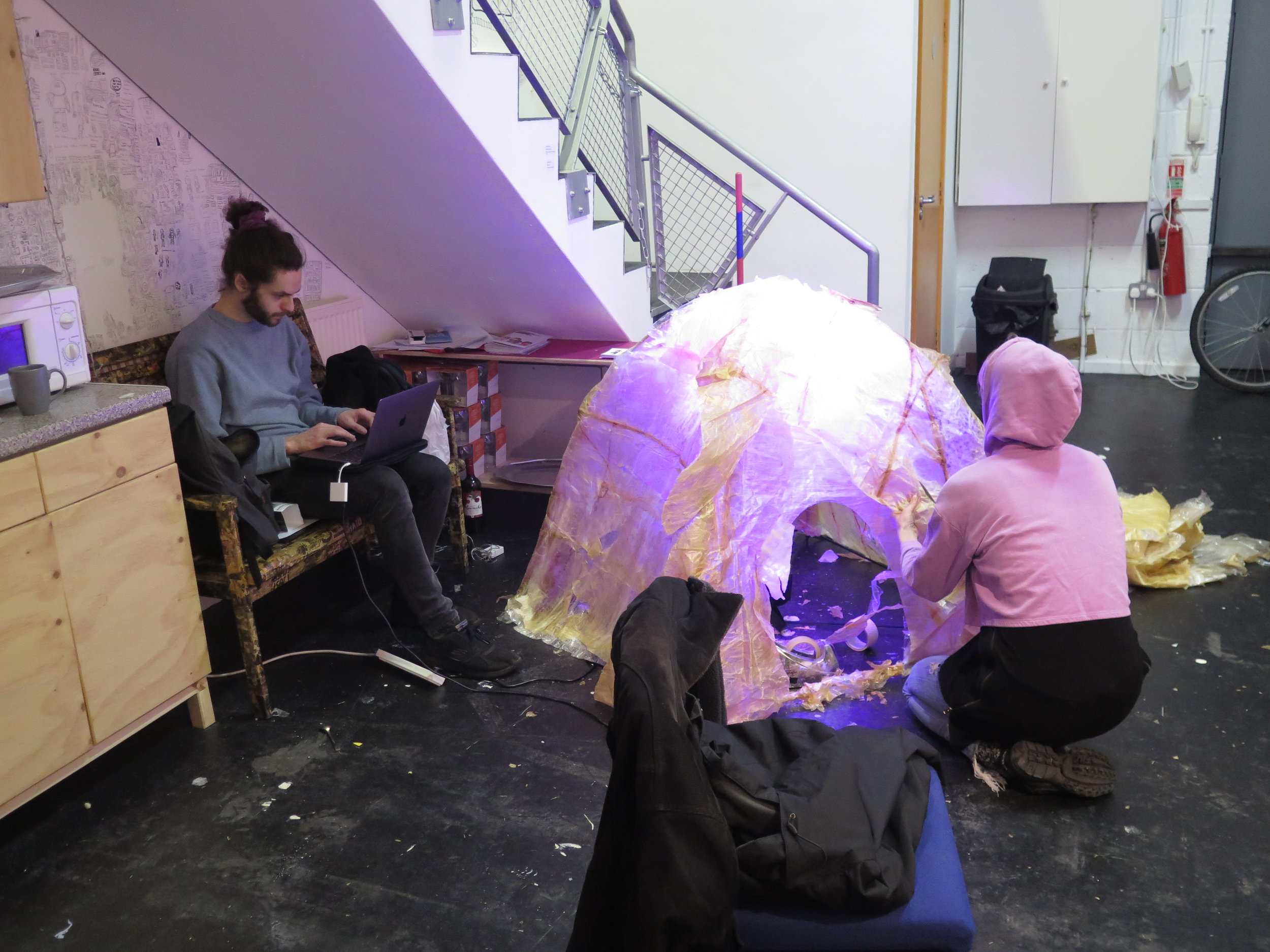 Fran finishing her experimental tent and working with Joe to light it in varying ways. Photo by James Pollitt
