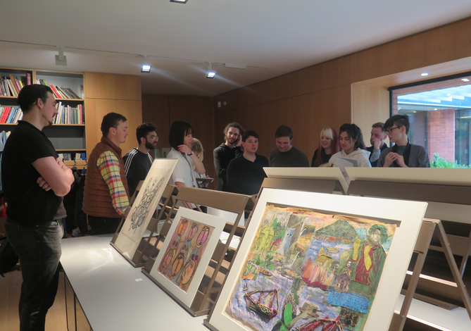 The group discussing some of the works during the first visit to the Musgrave Kinley Outsider Art Collection