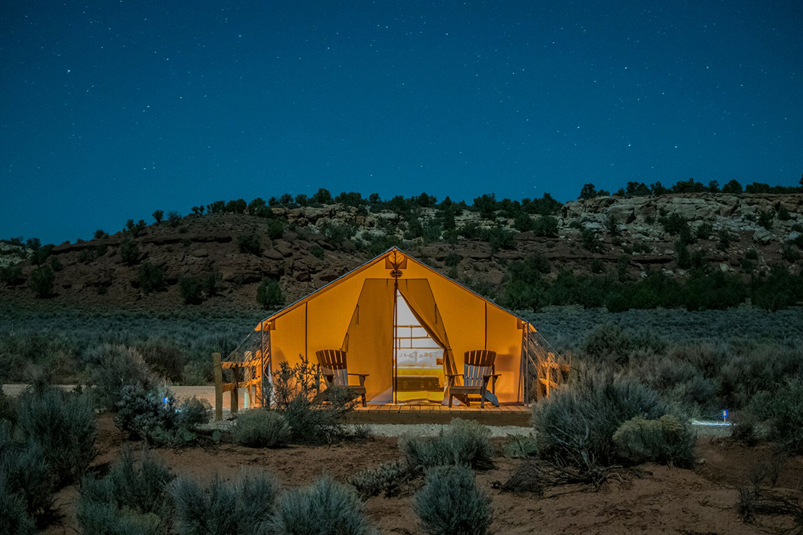 The Katie Lee Tent - Our tribute to a Glen Canyon icon. Wake up inspired in this tent named for the beloved environmentalist, activist, river runner, writer, folksinger and actress. A Cal King bed plus a full size futon makes the Katie Lee a great option for 3 adults or small families.