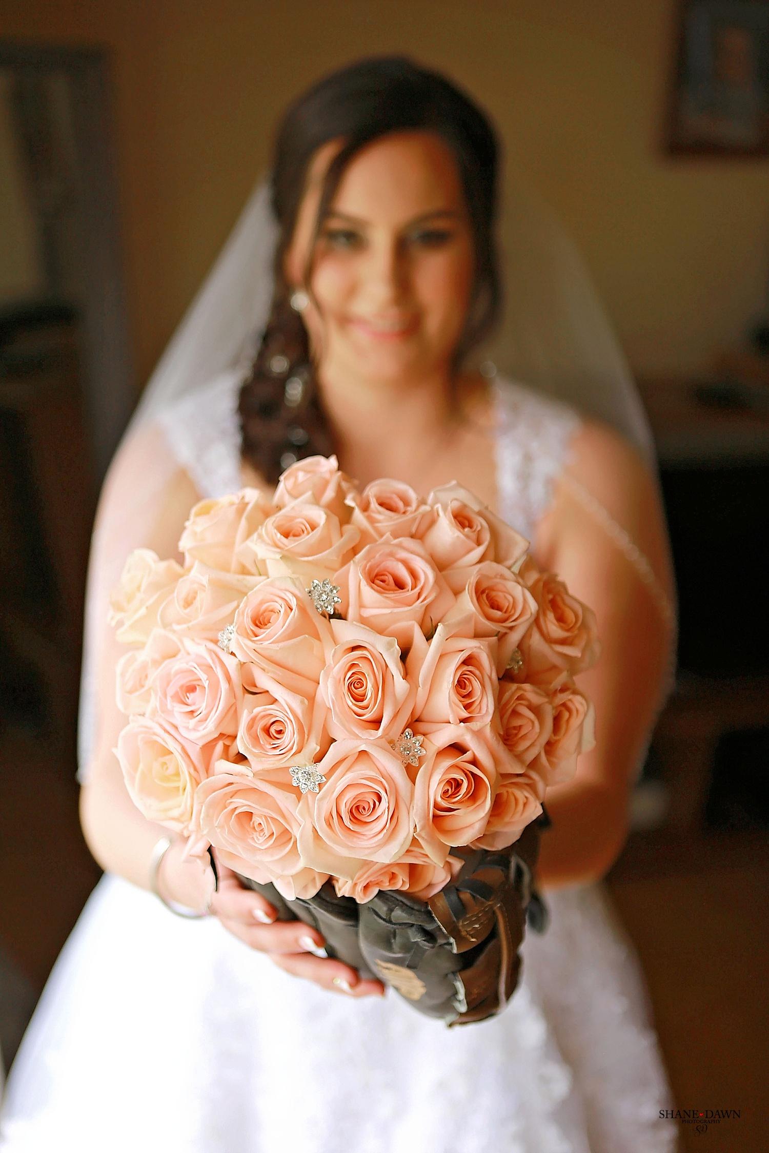 Bride with baseball glove flowers.JPG