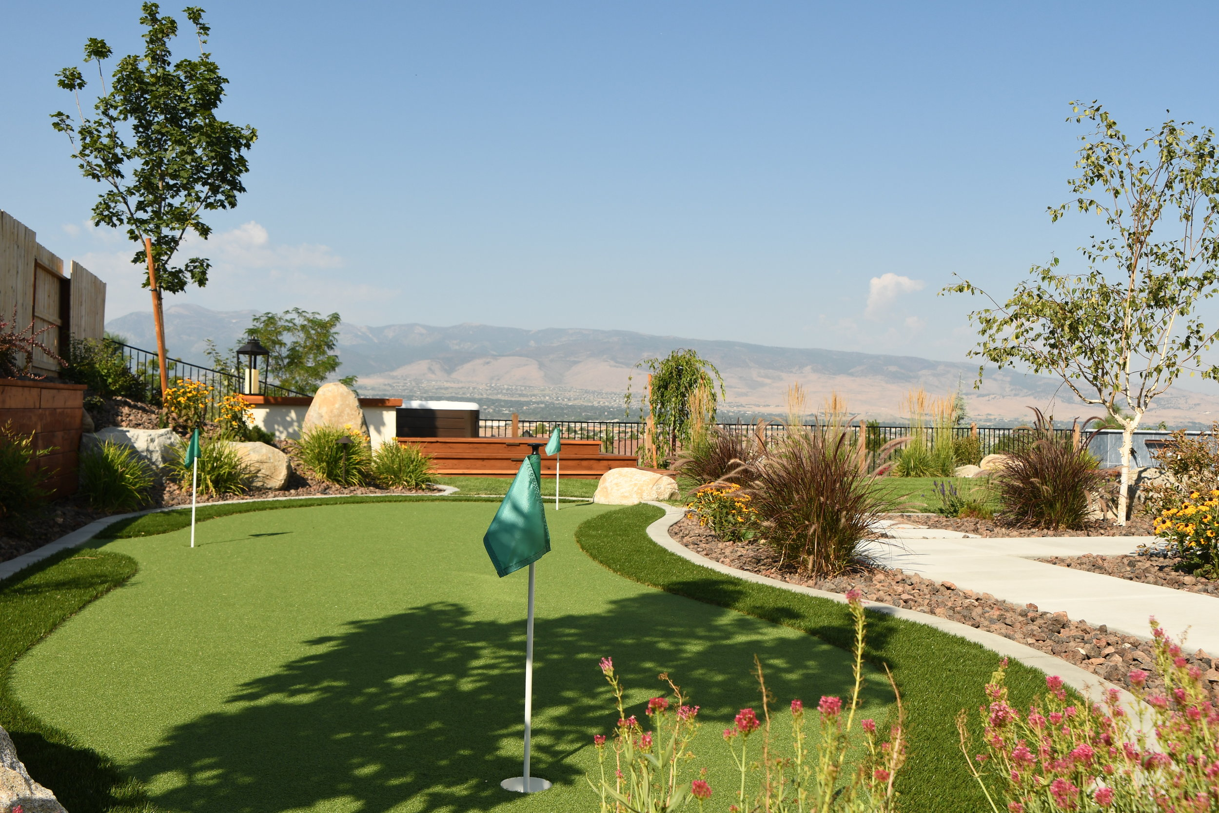 How a Landscape Designer Can Create a Backyard You'll Never Want to Leave with Game Courts in Sparks, NV