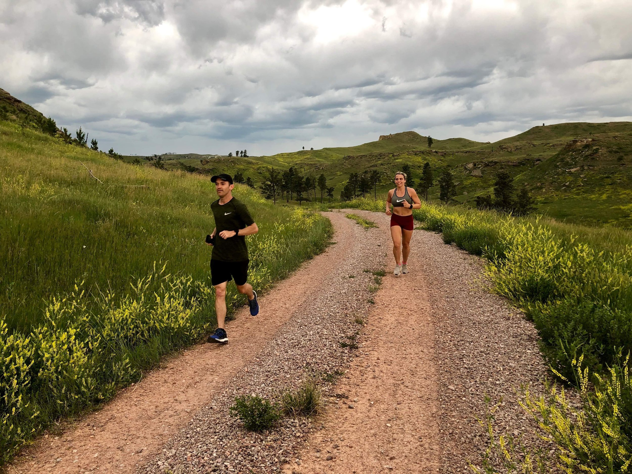 "Racing the thunderstorms in Montana: For years I've been planning the ""50 states 5k"" adventure to break the speed record for visiting all 50 states while also running a 5k in each state. I broke the record for most miles run a week (156.9 miles in 6 days), dealt with excessive heat, massive sleep deprivation and the stress of nearly having the whole trip blow up in my face over cancelled flights to the starting line. But in the end, it was executed in spite of obstacles and the dream was realized. This photo encapsultes the entire experiece. The storms were coming but we always fought to stay ahead of them."
