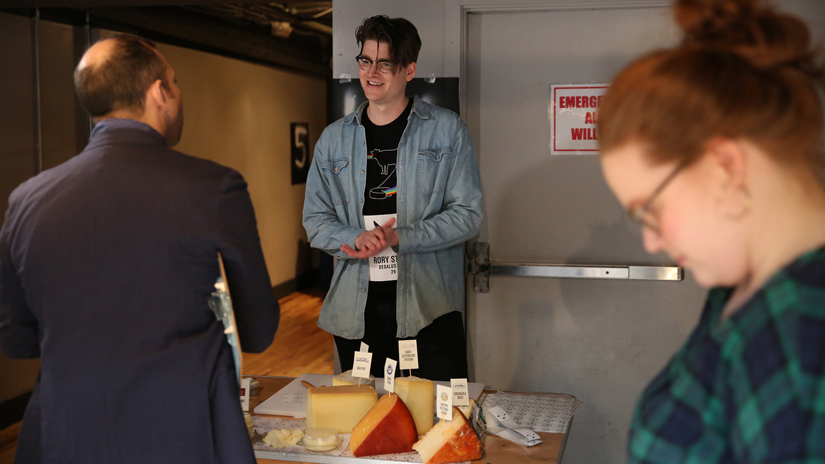 The winner of the 2018 Cheesemonger Invitational, Rory Stamp of Dedalus Wine in Burlington, Vermont, participates in the salesmanship portion of the competition. Judges grade the cheesemongers on their ability to answer customer questions and to articulate the tasting notes of various cheeses. Photo by Ellen Cronin.