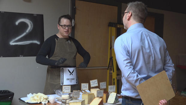 A competitor at the Cheesemonger Invitational in San Francisco. CBS News