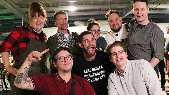 Seven past CMI champions accepted the challenge. Back row, from left: Jessica Lawrenz (Winter 2017 champion) of Venissimo Cheese, Matt Rubiner (2010) of Rubiner's Cheesemongers & Grocers, Lilith Spencer (Winter 2016) of Bklyn Larder, Perry Soulos (Winter 2014) of Euro USA and Eric Schack (Summer 2018) of Eataly. Front row, from left: Jordan Edwards (Summer 2017) of Regalis Foods, host and founder Adam Moskowitz and Rory Stamp (Winter 2018) of MidwestRoots and COD Consulting. Photograph: Robert Taylor