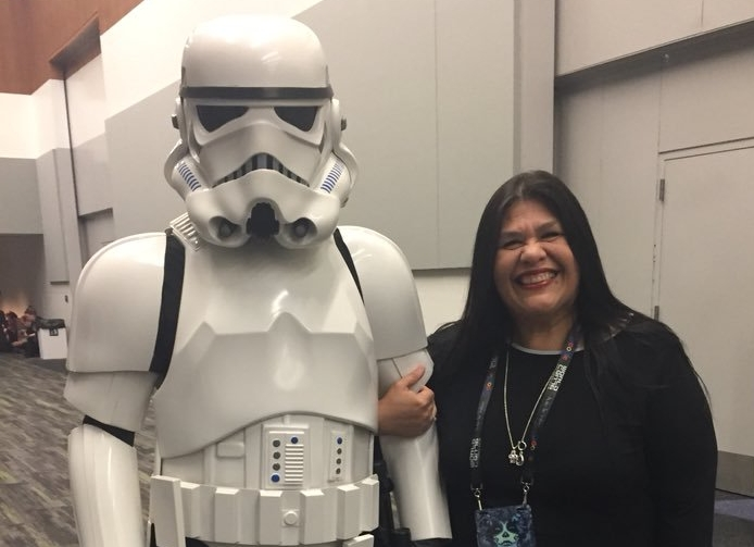 Guadalupe Garcia McCall with a stormtrooper at Worldcon 76 (Photo by Anonymous on Guadalupe's phone)