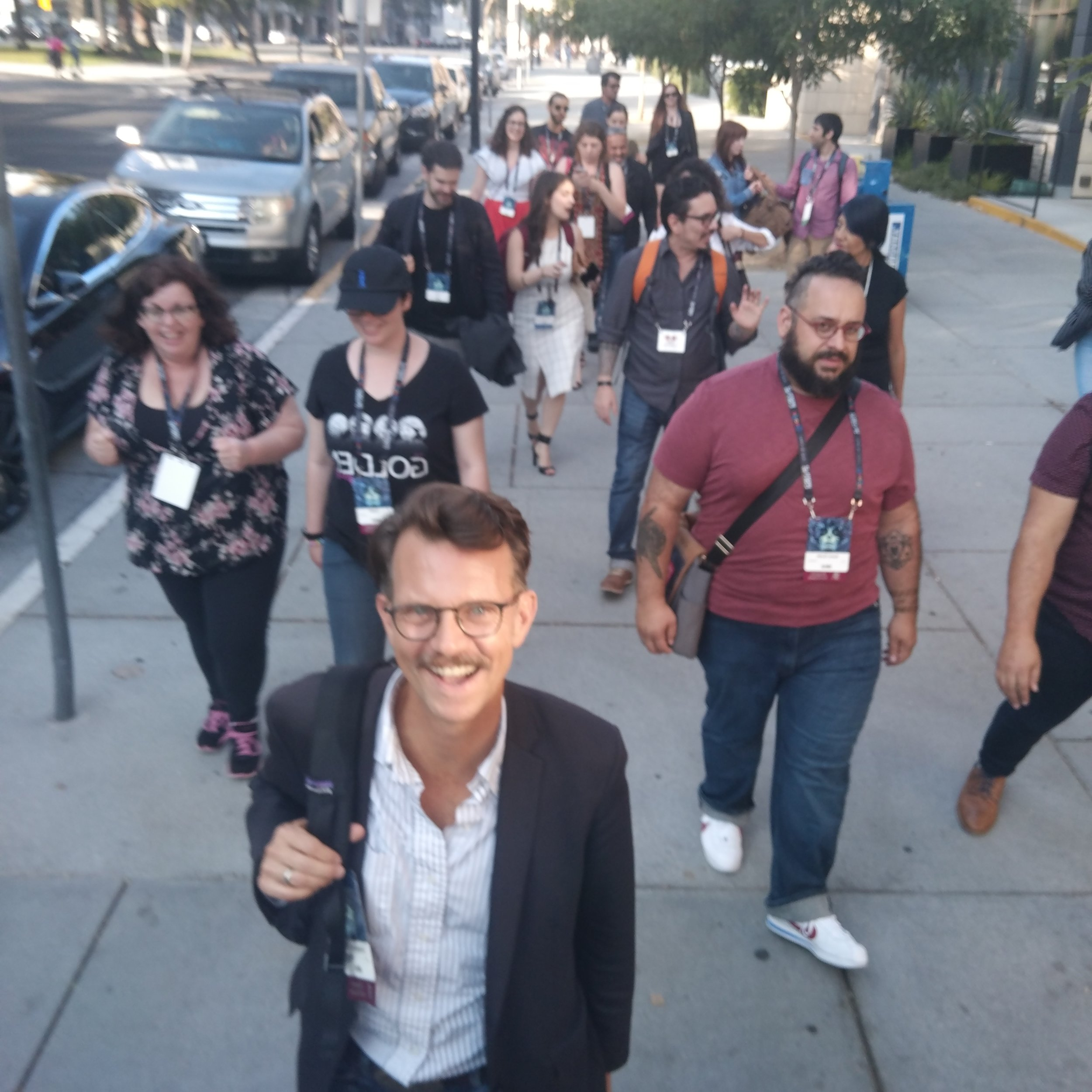 Chris N. Brown and a group of Mexicanx Initiative participants walking on the sidewalk in San Jose