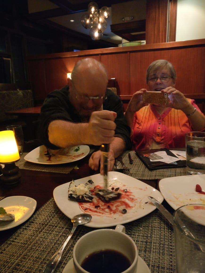 Joe Haldeman stabs a dessert
