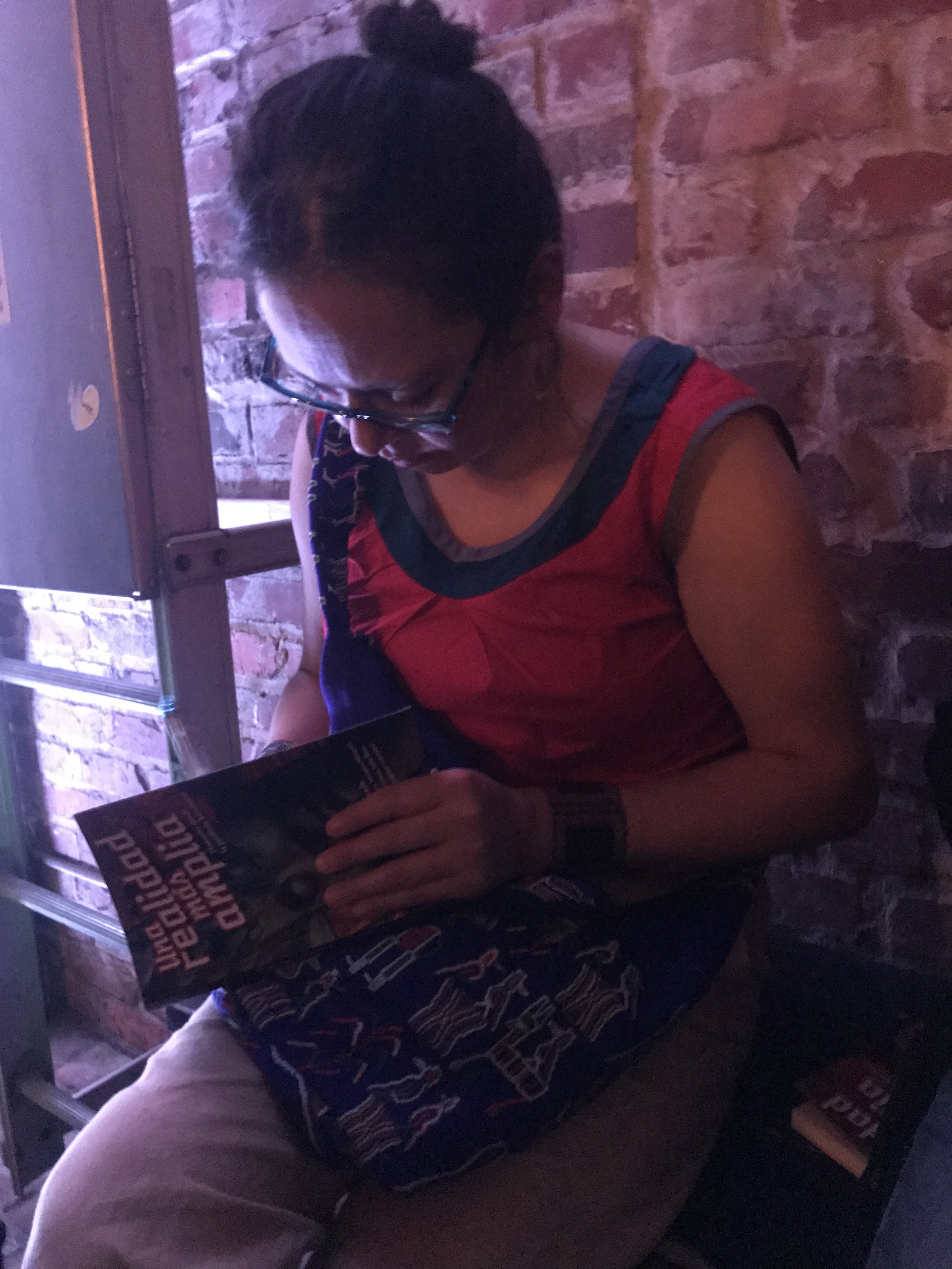 Libia Brenda holding a copy of the anthology she edited (Photo by Julia Rios)