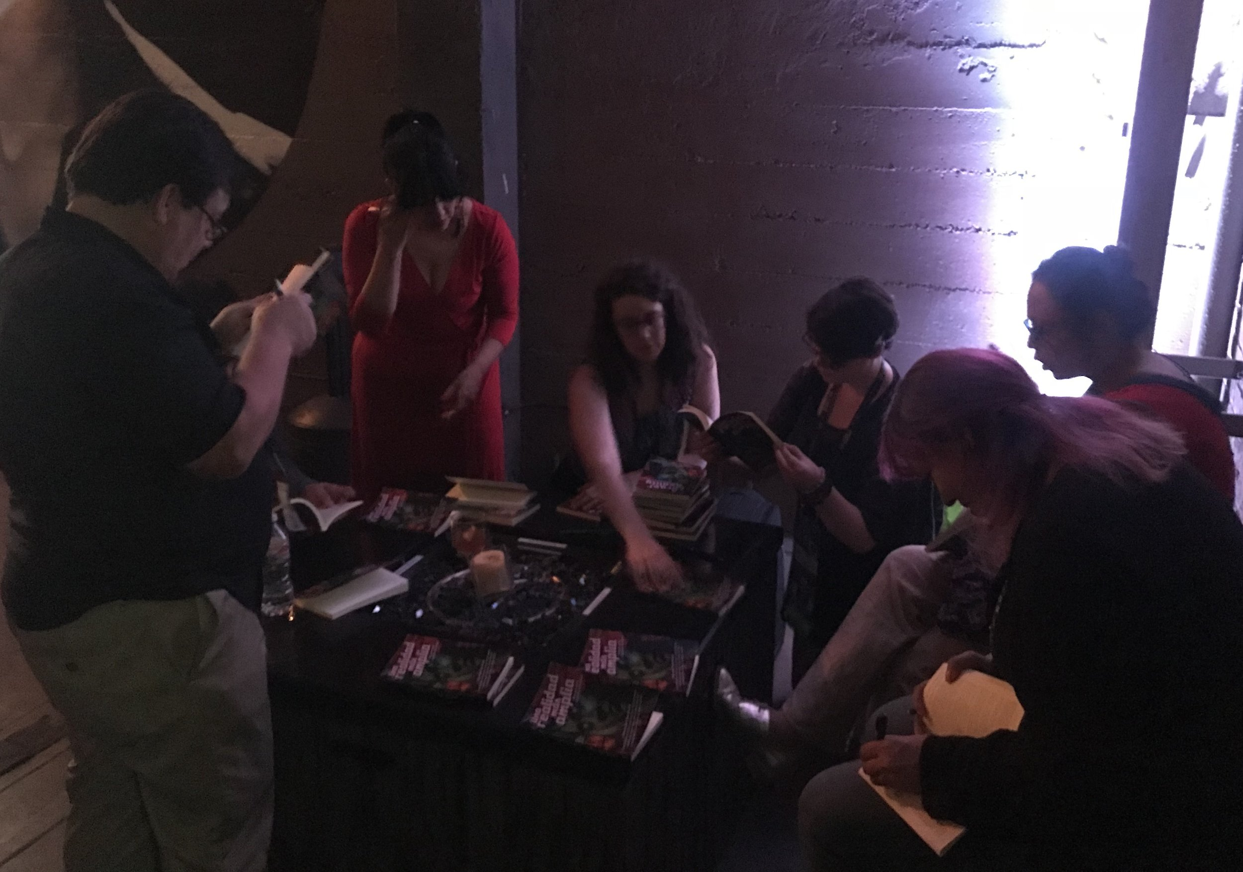 David Bowles, Gabriela Damián, Andrea Chapela, Angela Lujan, Libia Brenda, and Raquel Castro signing books for Kickstarter backers (Photo by Julia Rios)