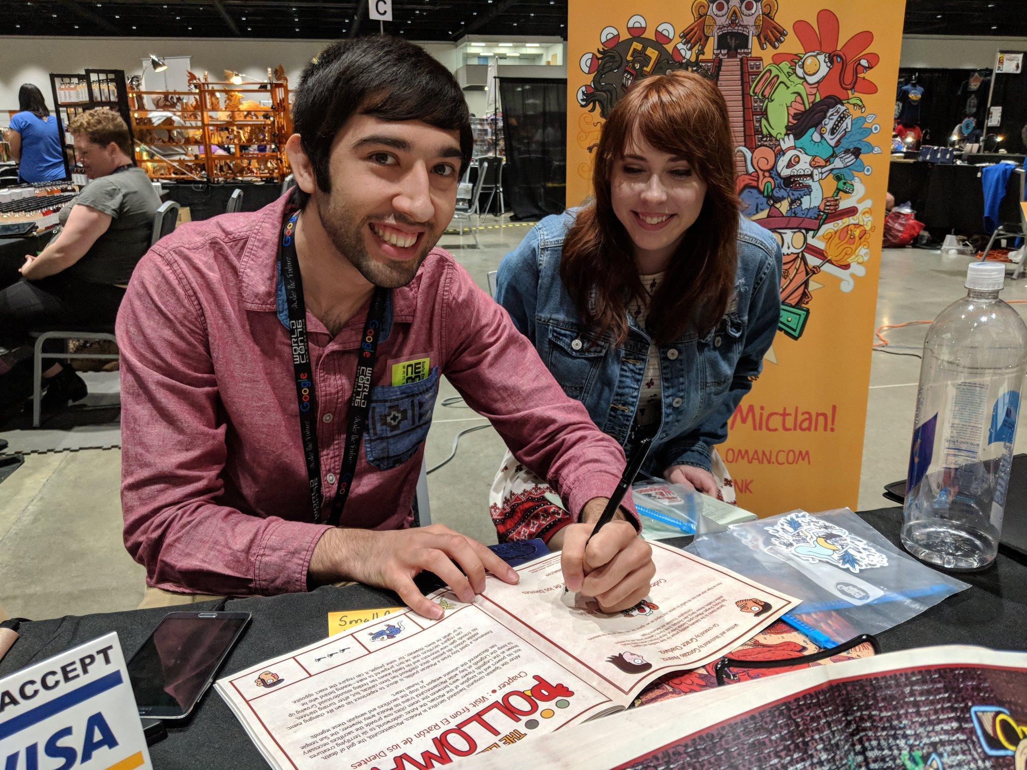 Gonzalo Alvarez signing a Polloman book (Sent by Gonzalo Alvarez; photo by Dianita Ceron)