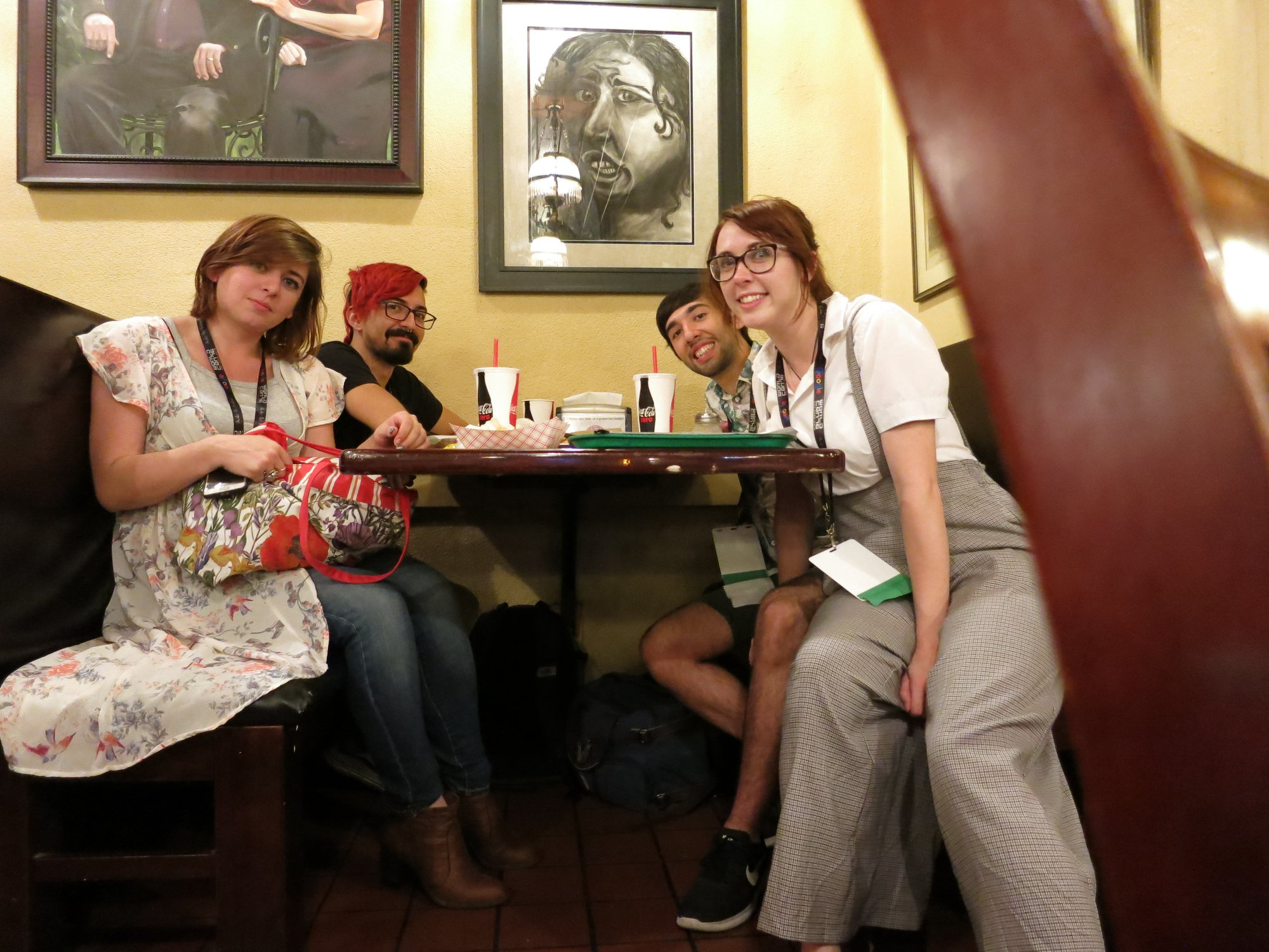 Mariana Palova, Cody Jimenez, Gonzalo Alvarez, and Grace Chadwick bonding over food at Worldcon 76 (Photo by Anonymous, taken on Gonzalo's phone)
