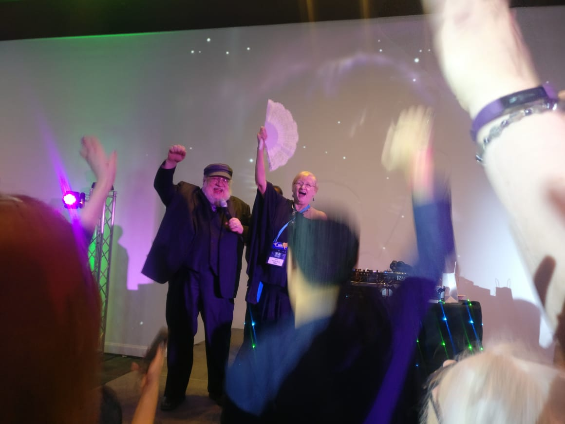 George R. R. Martin leading the crowd in a cheer at the Hugo Losers Party (Photo by Alberto Chimal)