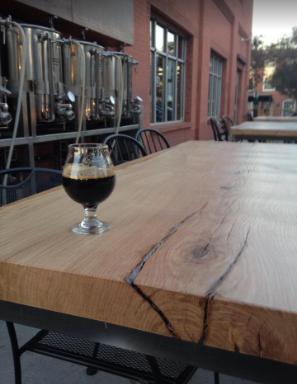 Live edge slab tables at Heist Brewery in NoDa