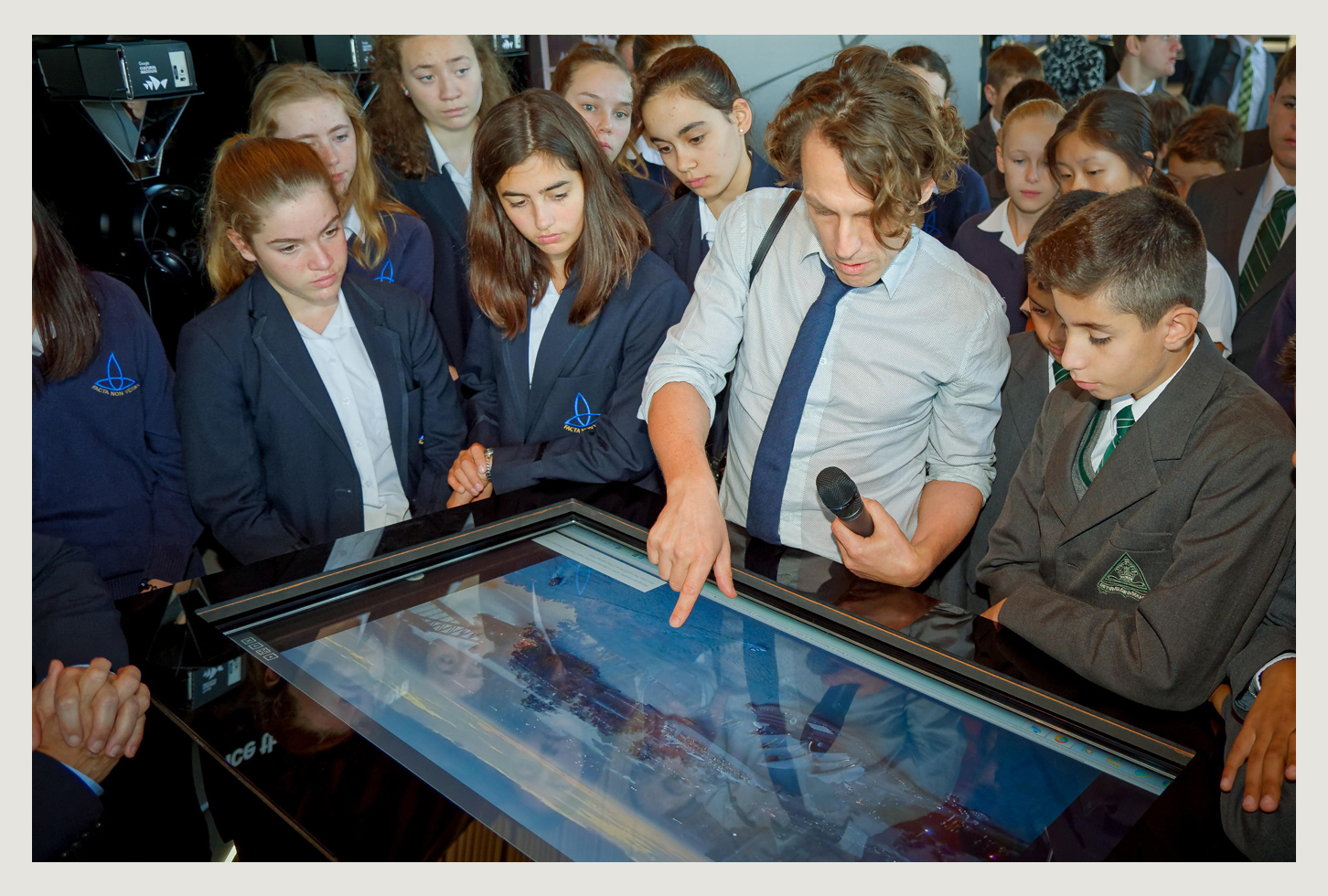 Taking school kids through aspects of the collection. Photo: Hugh Peterswald/Getty.