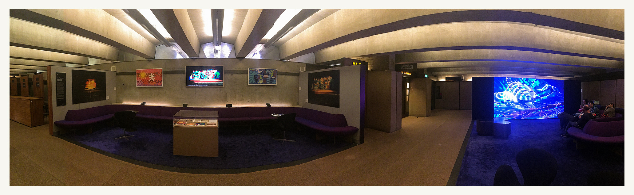 Panorama of The Lounge at Sydney Opera House. Exhibit space shows the curtains in 1973 alongside the original (painted) designs. Also a video slideshow and display box of ephemera.