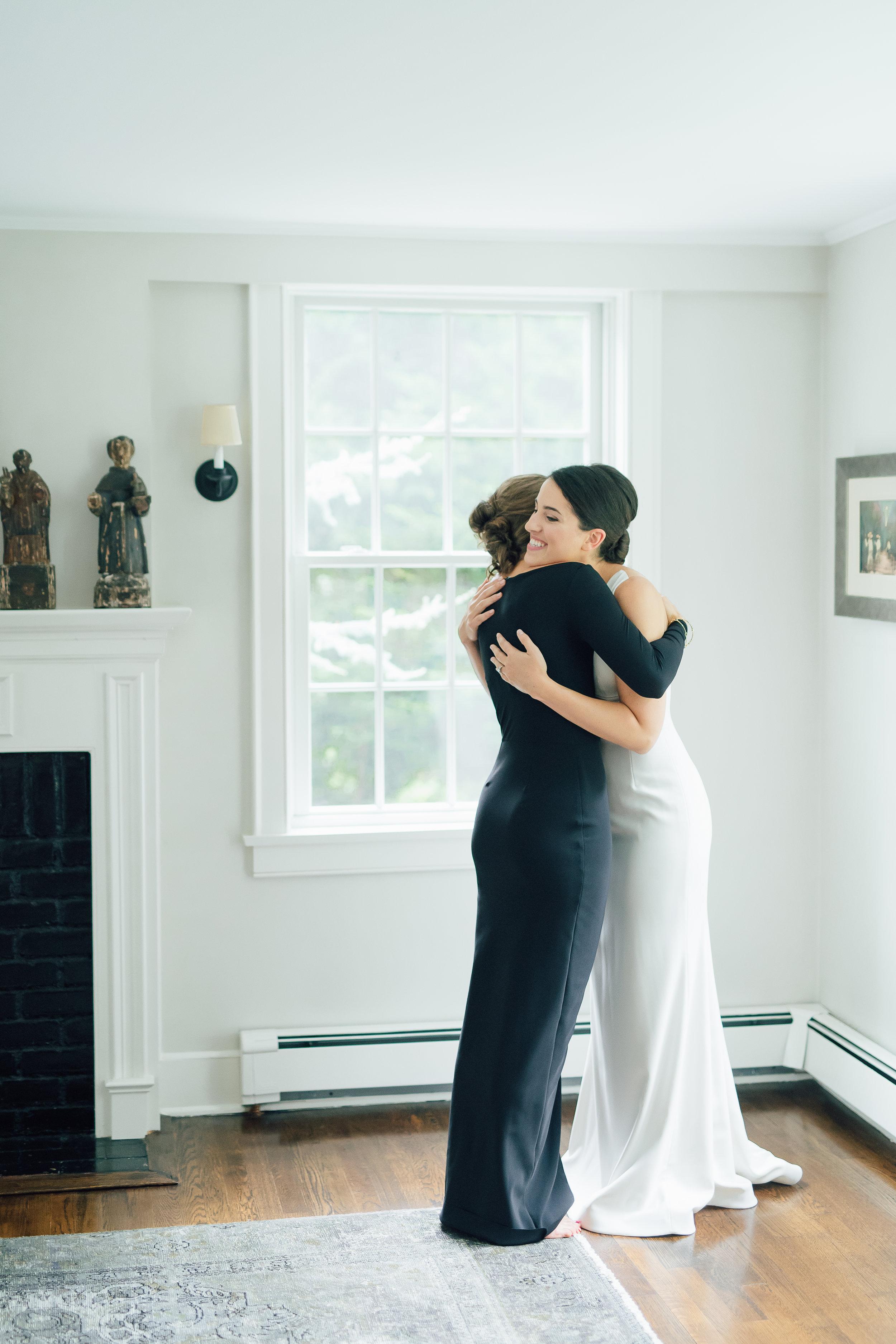 westport wedding photographer_bride and sister hug
