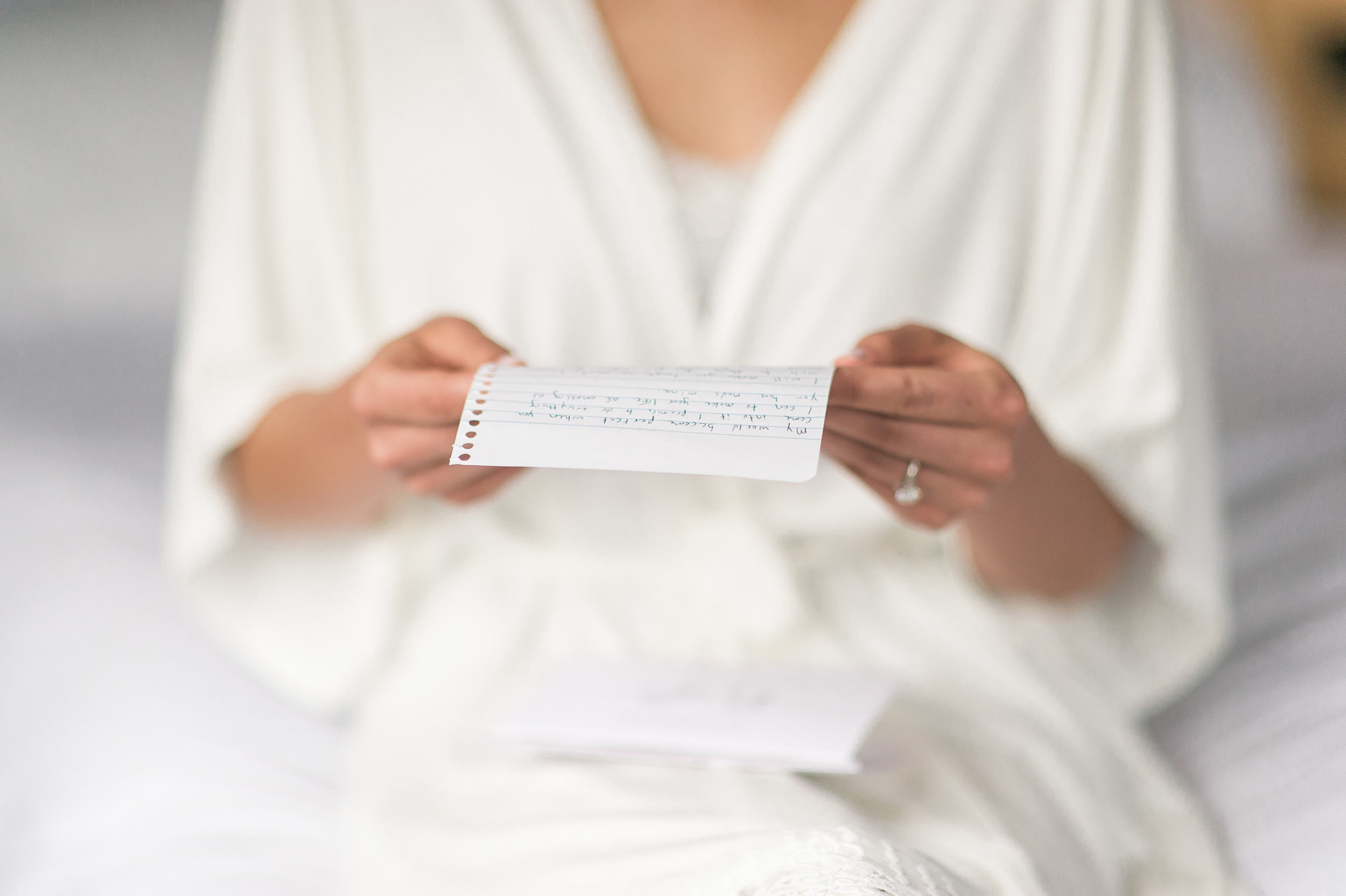 bride reading love letter lace factory wedding