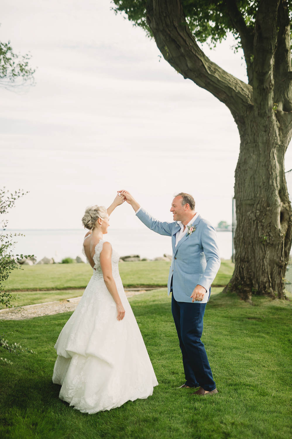 bride and groom portraits by the water_stamford yacht club inspired wedding