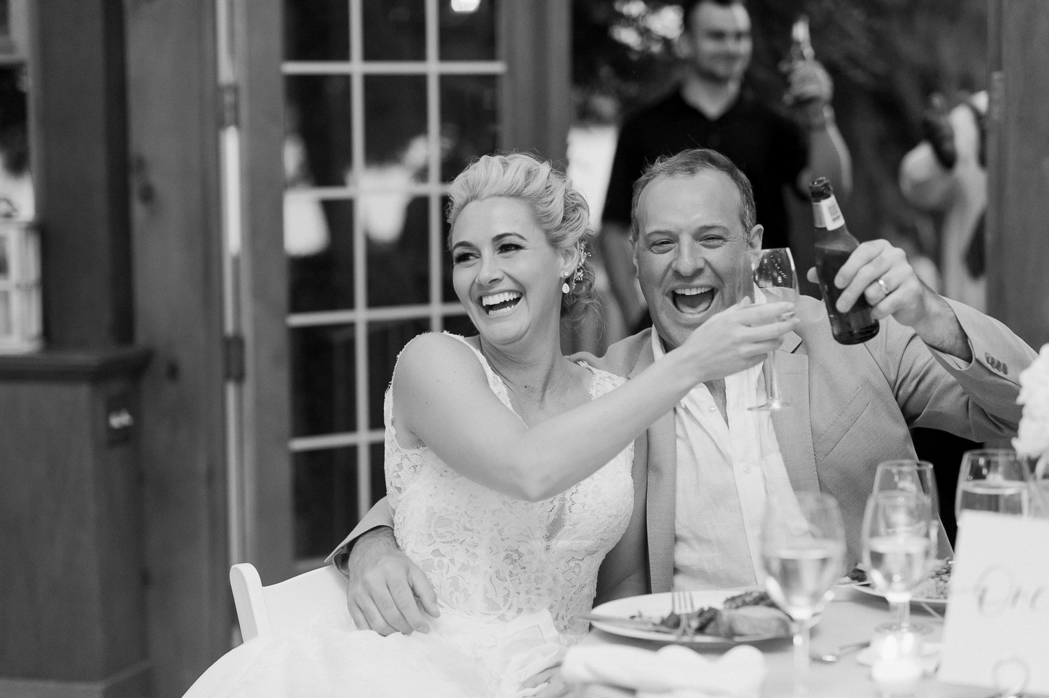bride and groom toasts_stamford wedding photographer_stamford yacht club inspired wedding