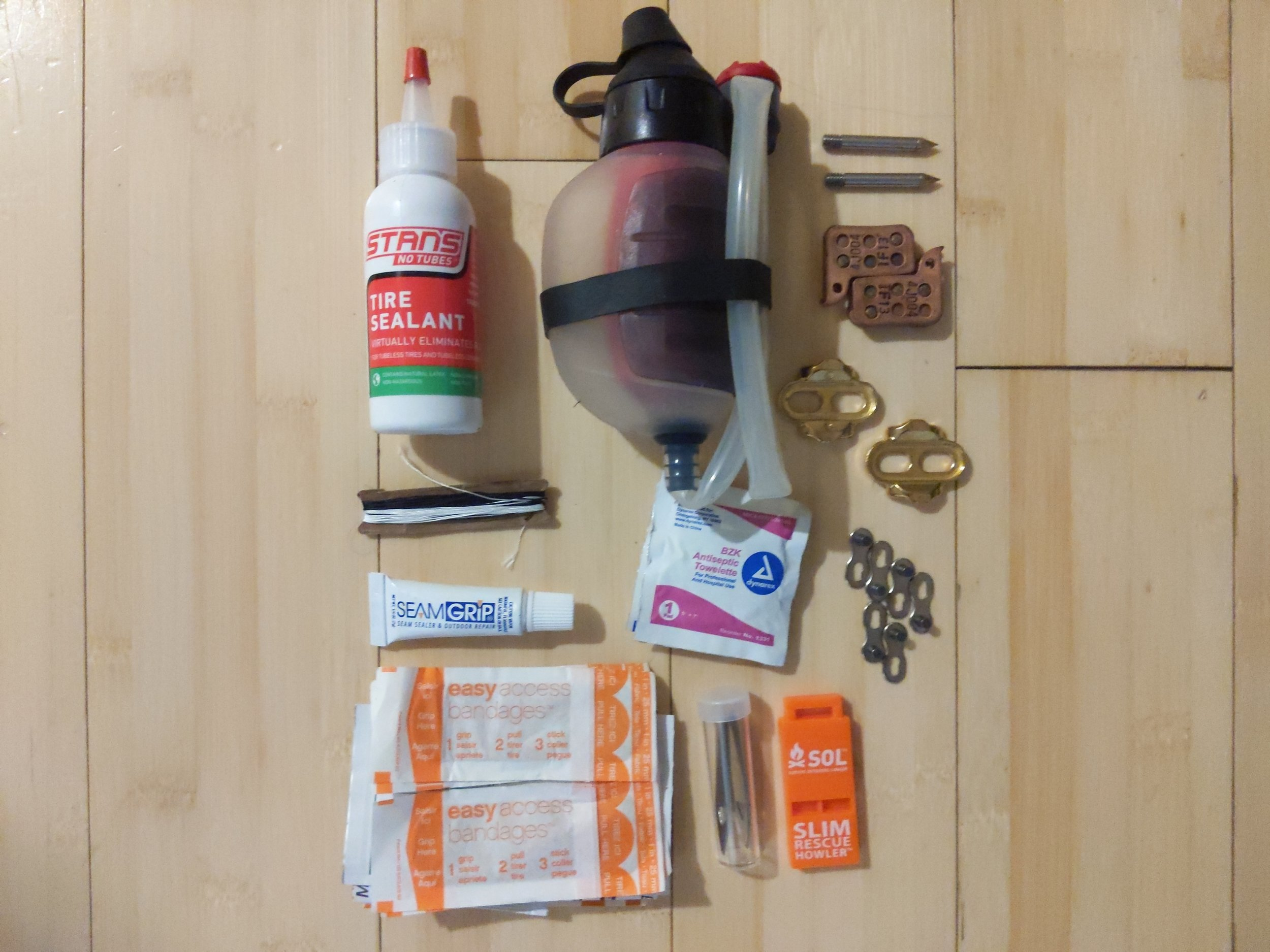 JPaks FramePak (bottom) - First Aid KitMSR Trailshot water filterSewing kitSpare brake pads, pedal cleats, and chain linksTire sealant
