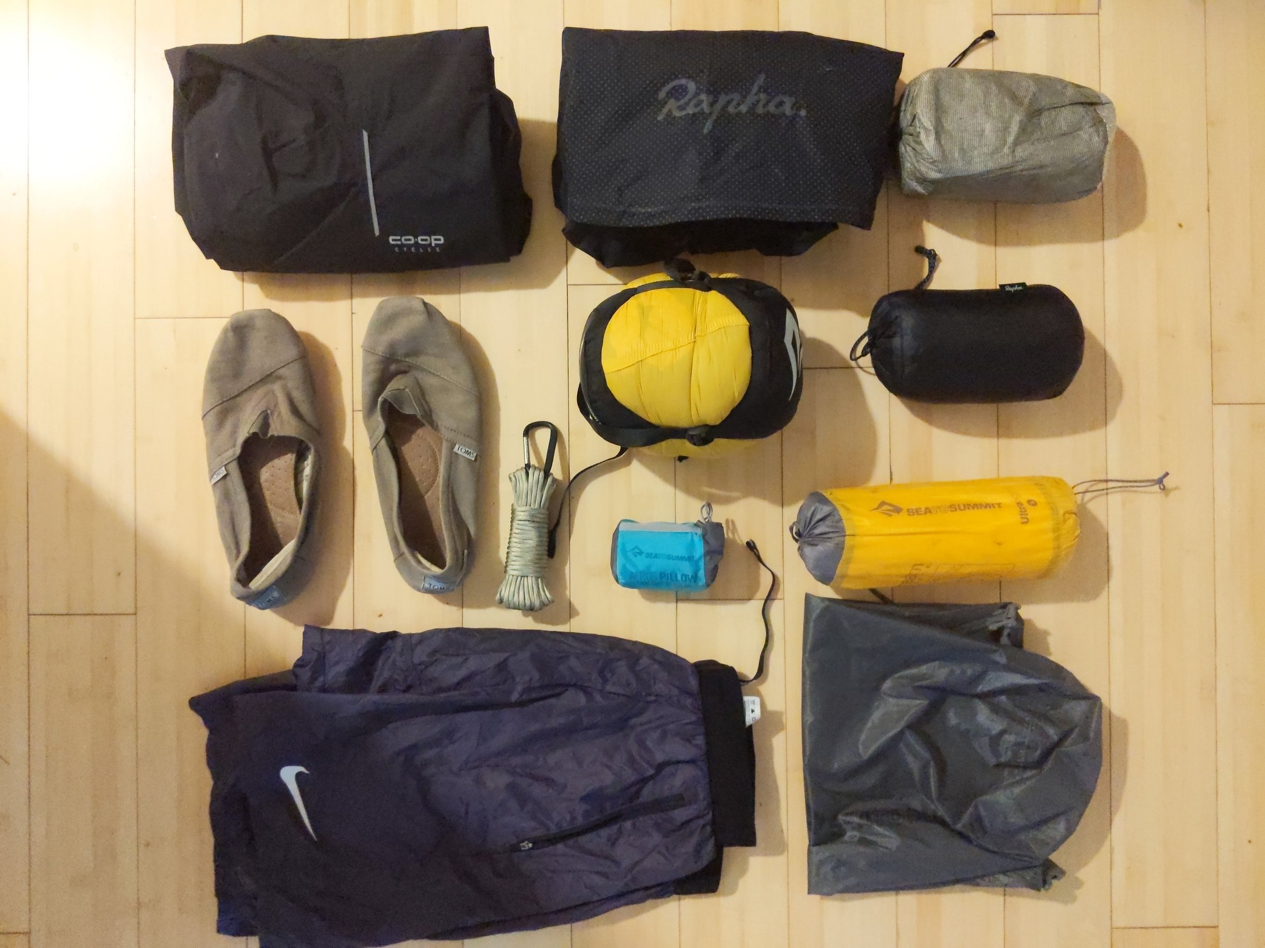 JPaks SeatPak - Sea to Summit Spark SP II Sleeping BagSea to Summit Ultralight Air Sleeping MatSea to Summit Aeros Ultralight PillowSOL Escape BivyRapha Explore Down JacketRapha Commuter JacketCo-op Cycles Rain PantsGear Aid Paracord for tying up foodHeadband light for camp (not pictured)