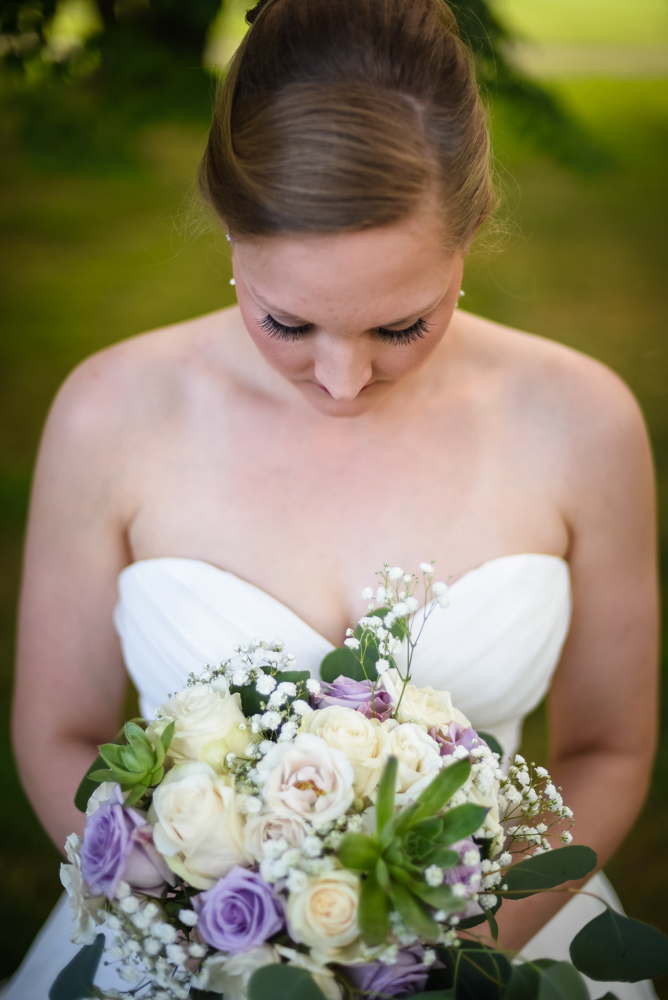 bridal photography, bride looking down at wedding bouquet