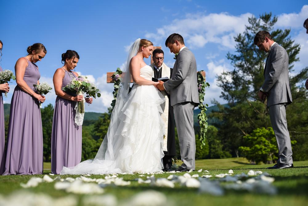 wedding ceremony, bride and groom praying