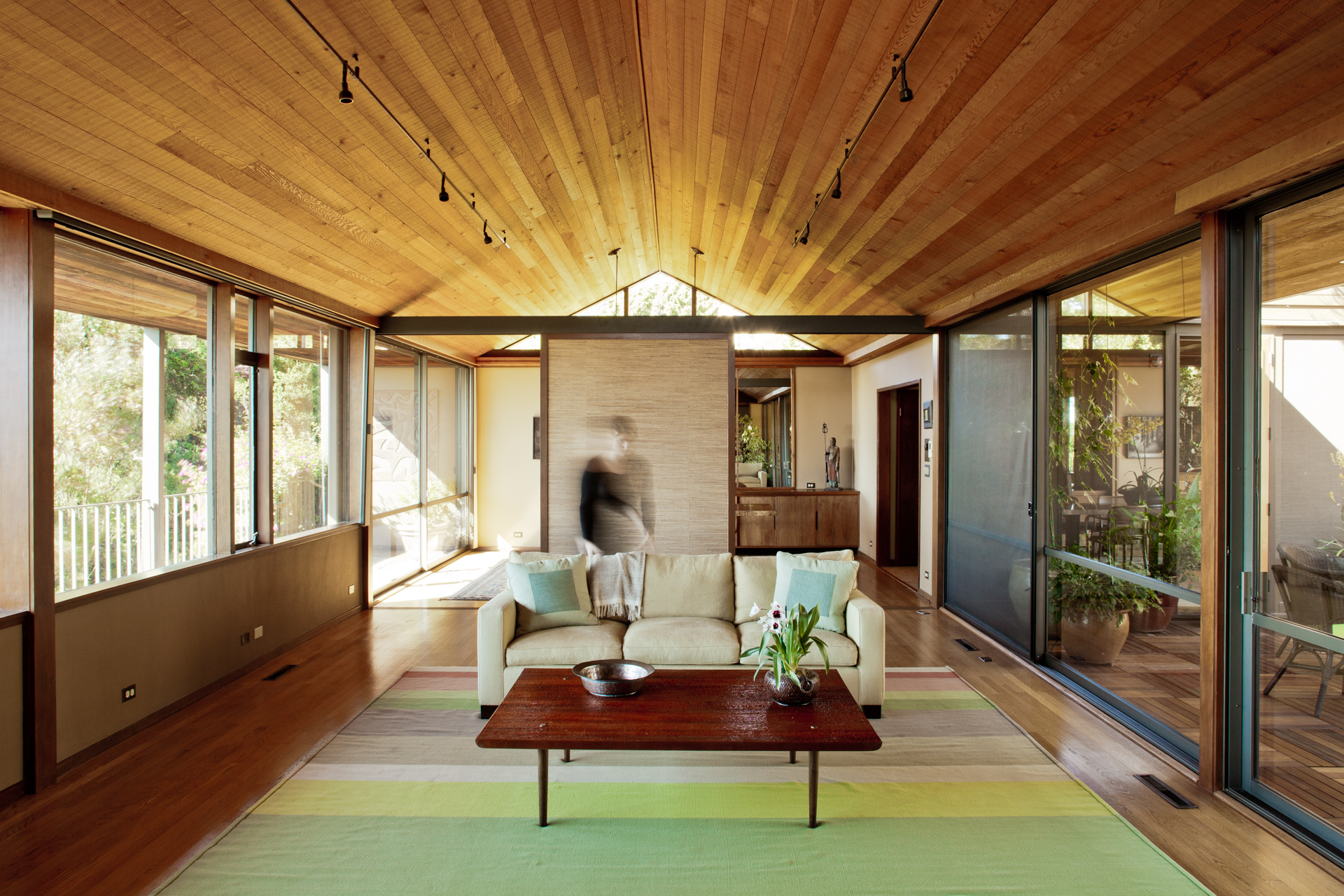 Mid-Century modern house features glass walls onto porch and to inner courtyard.