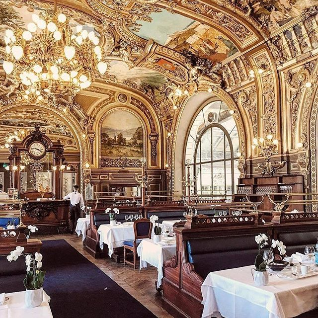 """Le Train Bleu (""""The Blue Train""""), a restaurant located in the hall of the Gare de Lyon railway station in Paris, France. It was designated a Monument Historique in 1972."""