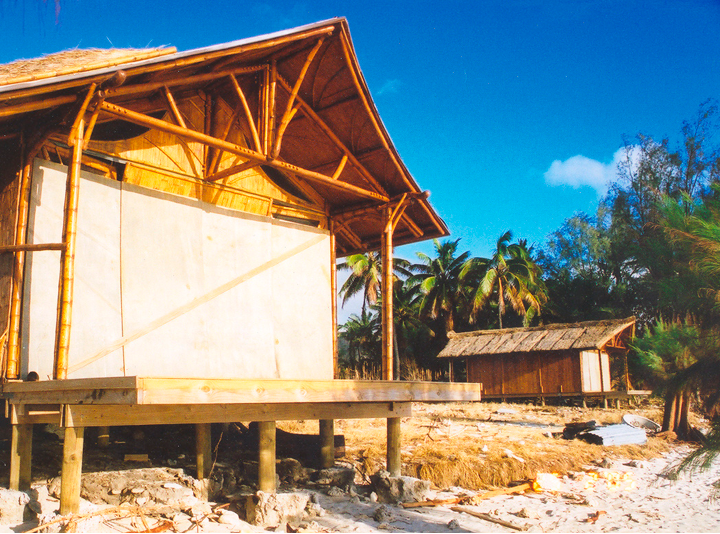 Bamboo Living cottage in Rarotonga  after  hurricane Olaf. Windows boarded up to protect the glass.