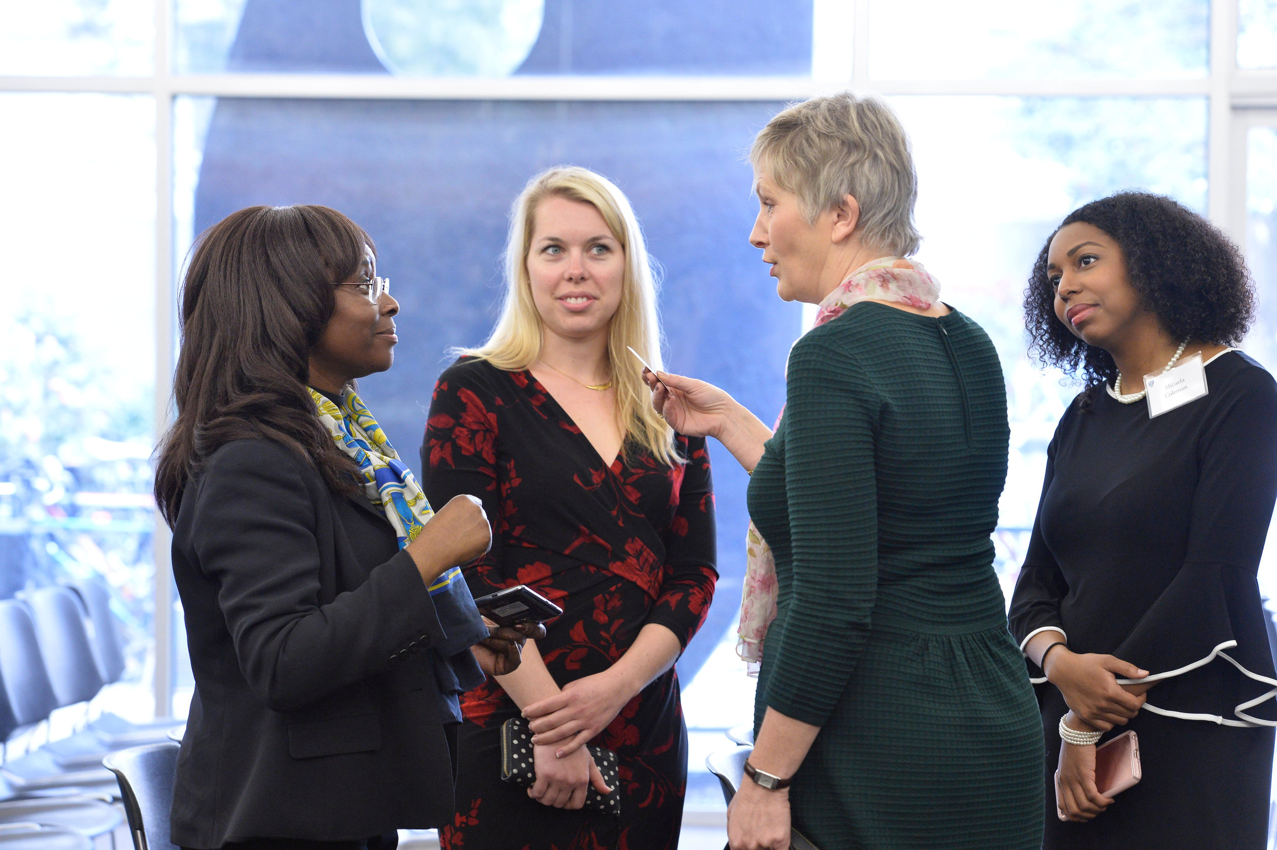 Attendees speak with Deputy Head of the EU Delegation to the United States Caroline Vicini after a panel on women in politics