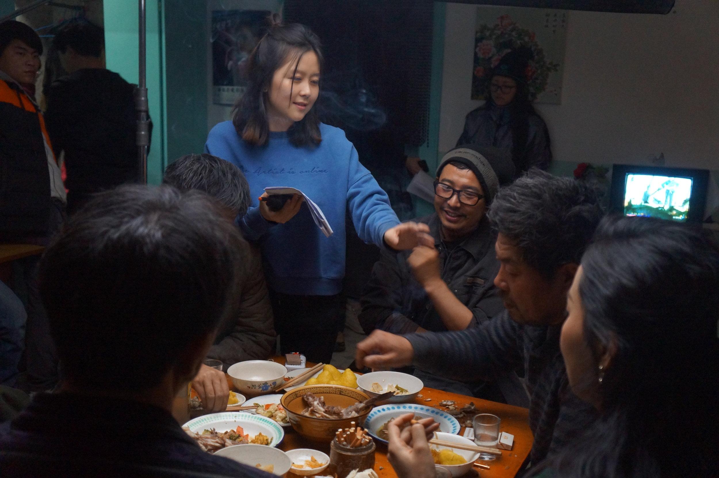 "Yuan Yuan directing on set of ""Heading South"" in China"