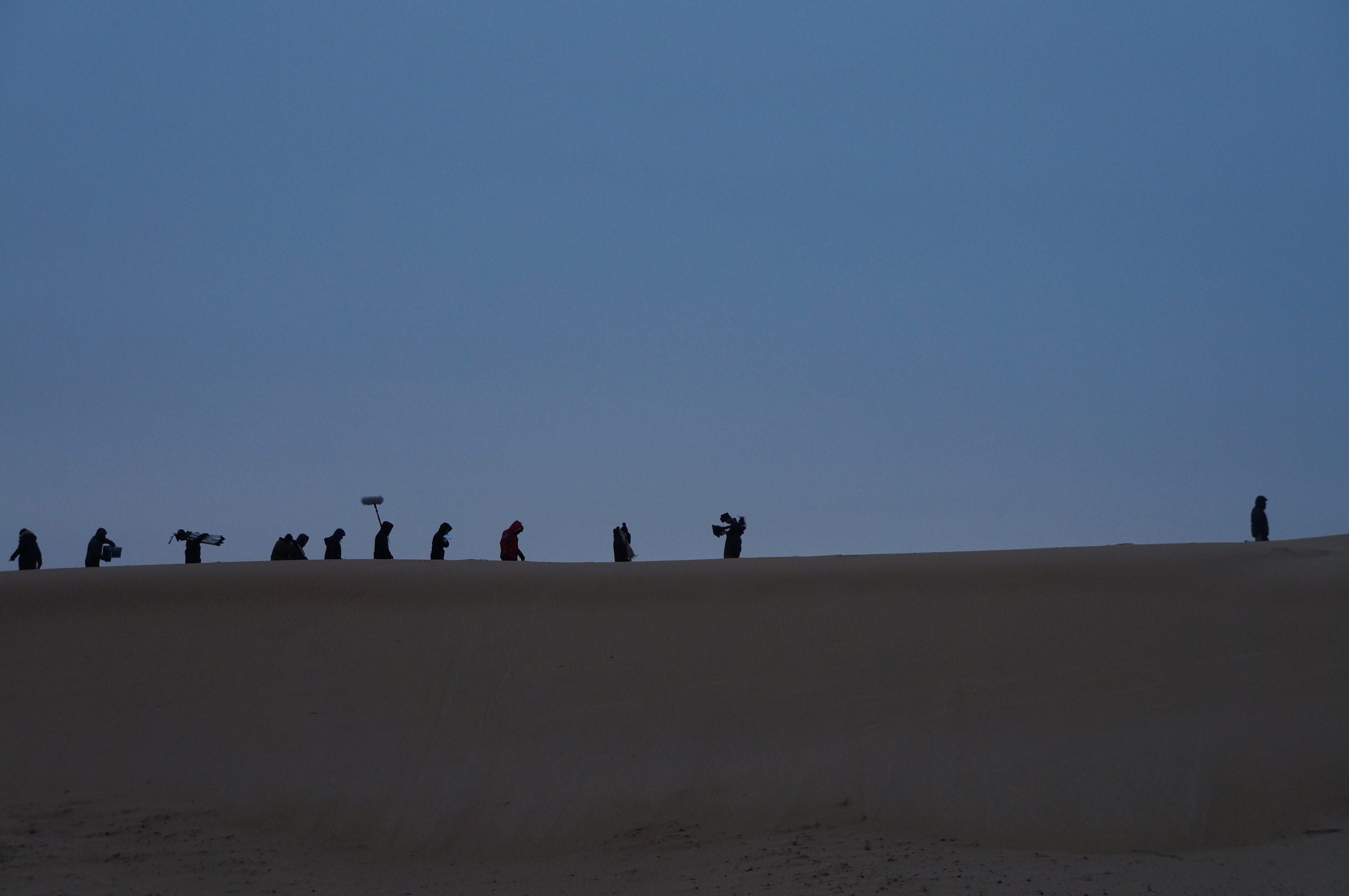 """Crew carrying equipment on set of """"Heading South"""" in China"""