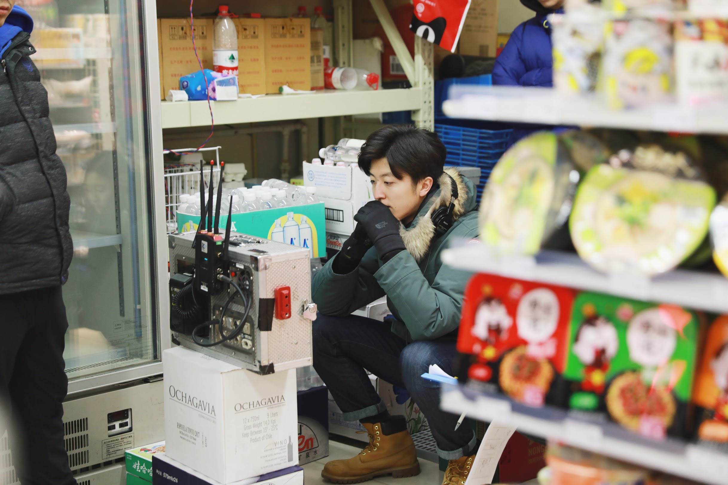 Yulin Yang watching monitor on set in China