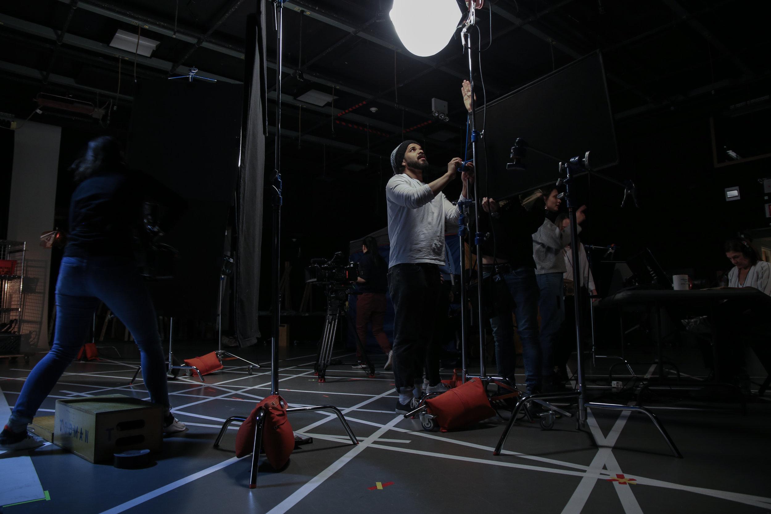 Crew working on Clara Dubau's set in USA
