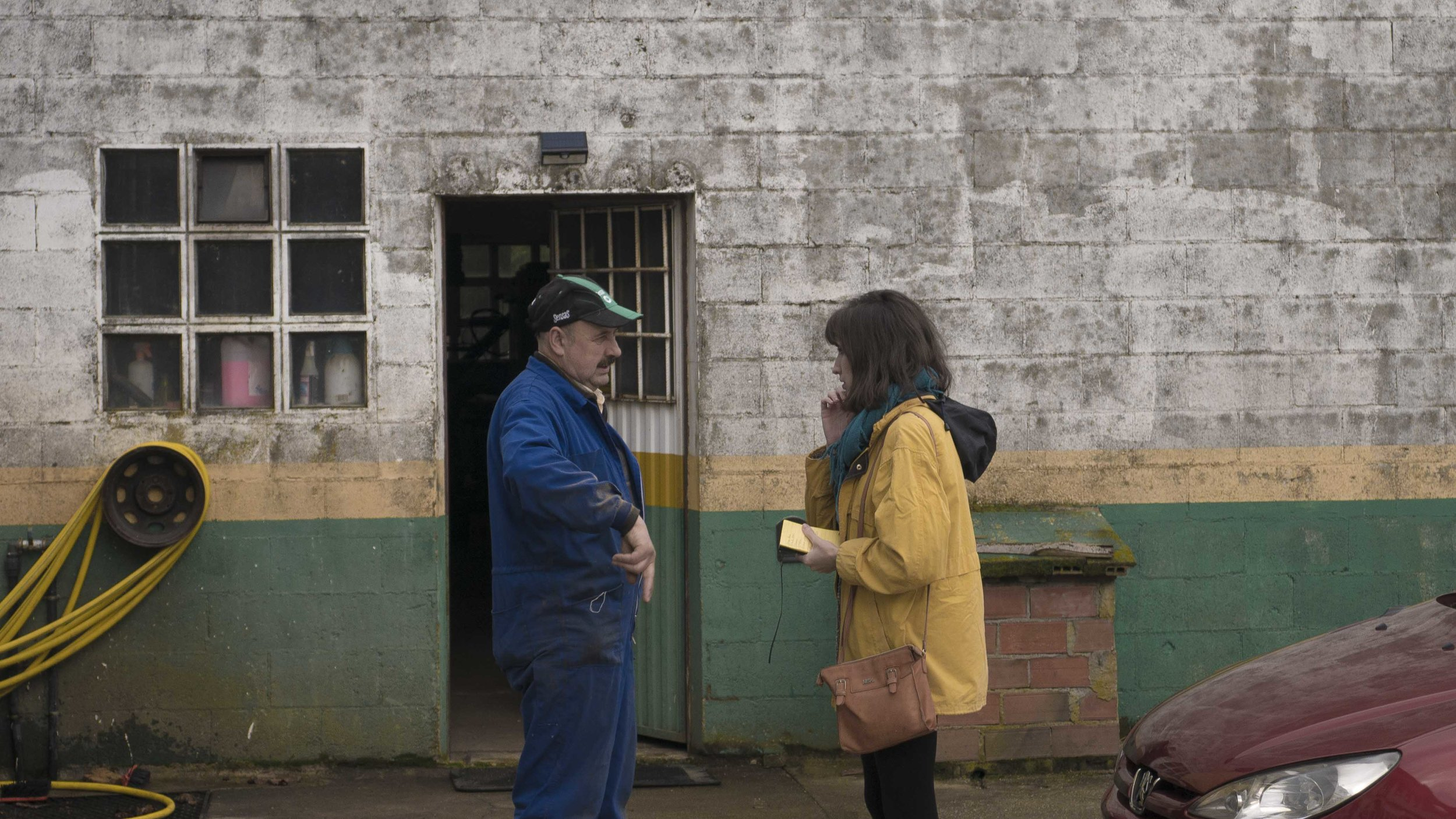 Noelia María Muíño González talking to a crew member on holding area in Spain