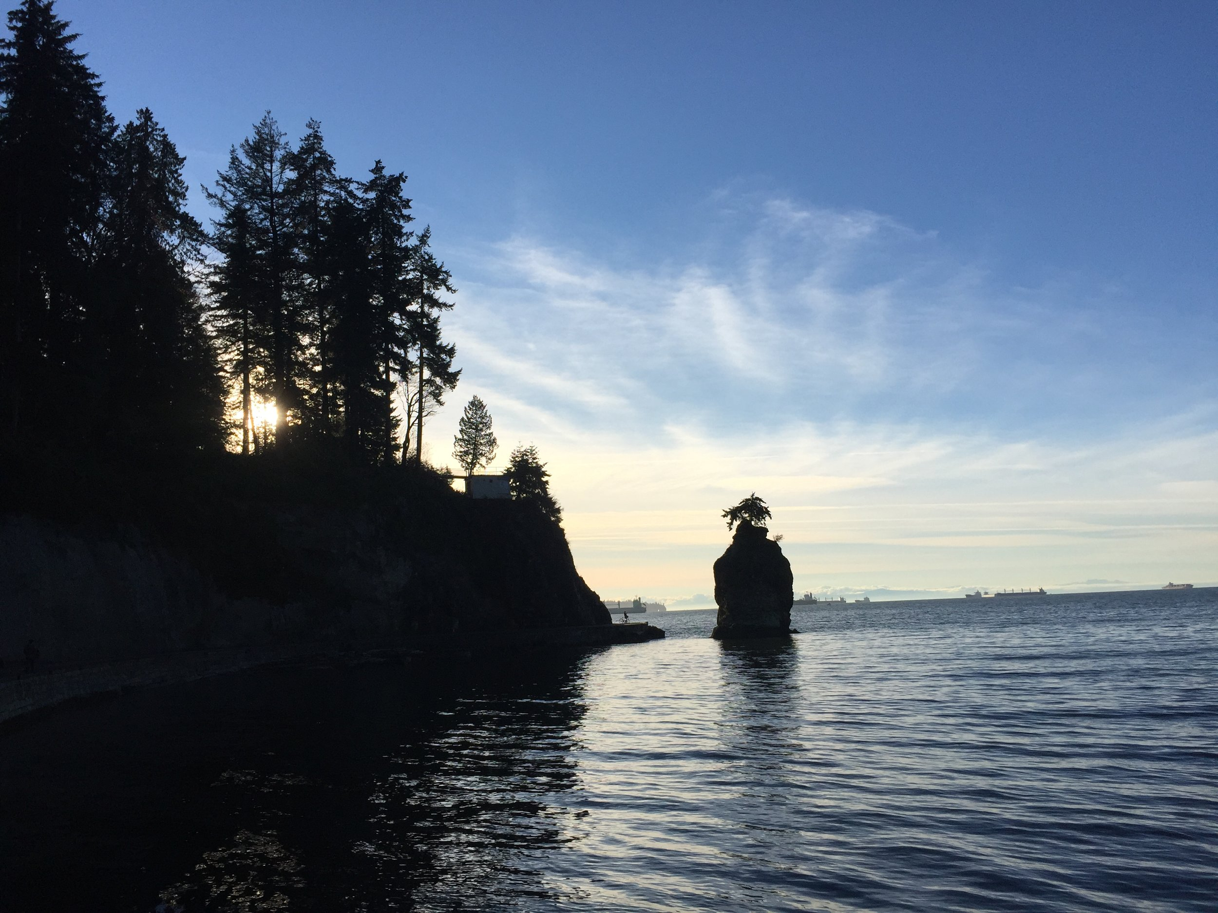 Sunset View Of Siwash Rock From the Seawall in Stanley Park