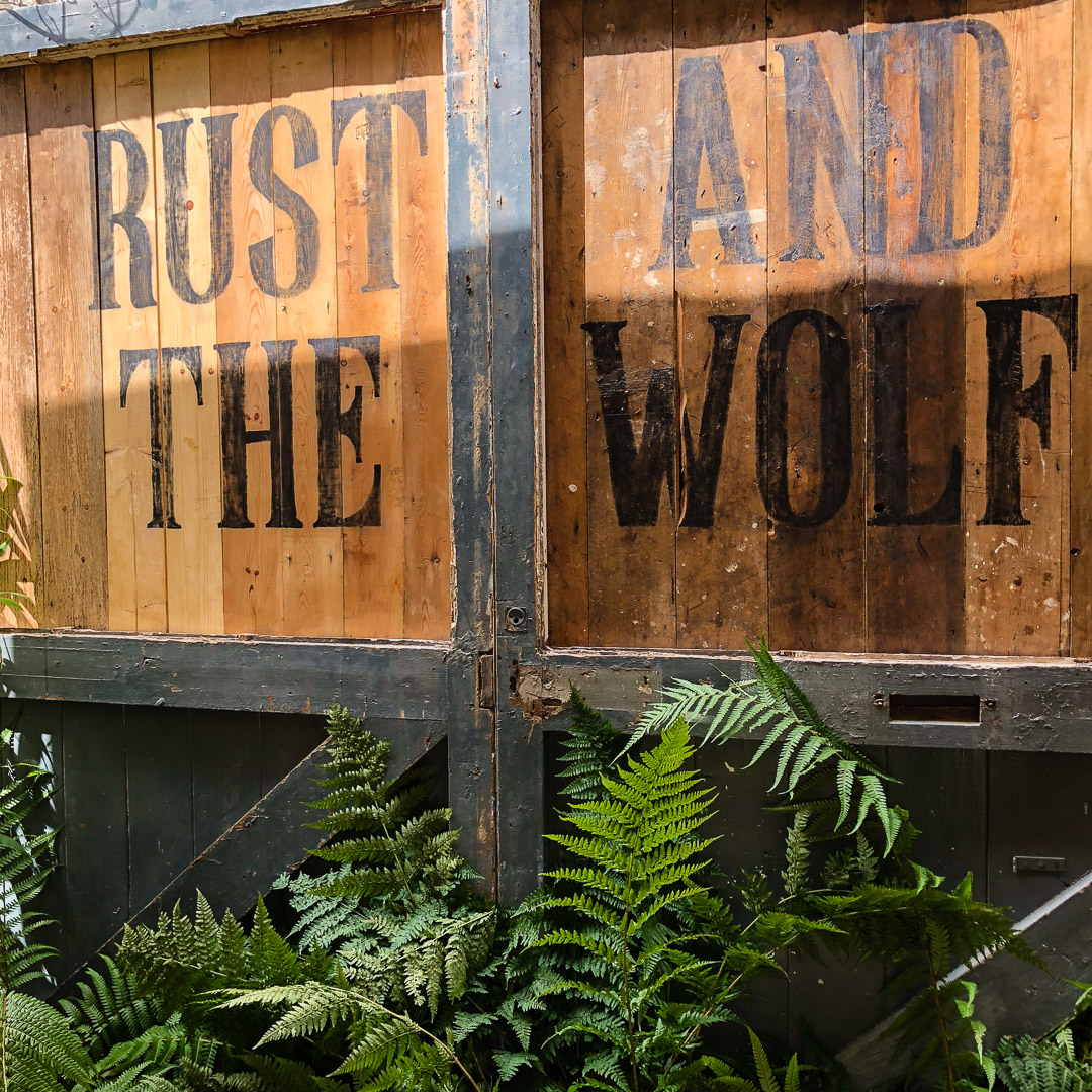 Rust And The Wolf - Café interior, window view, antique door