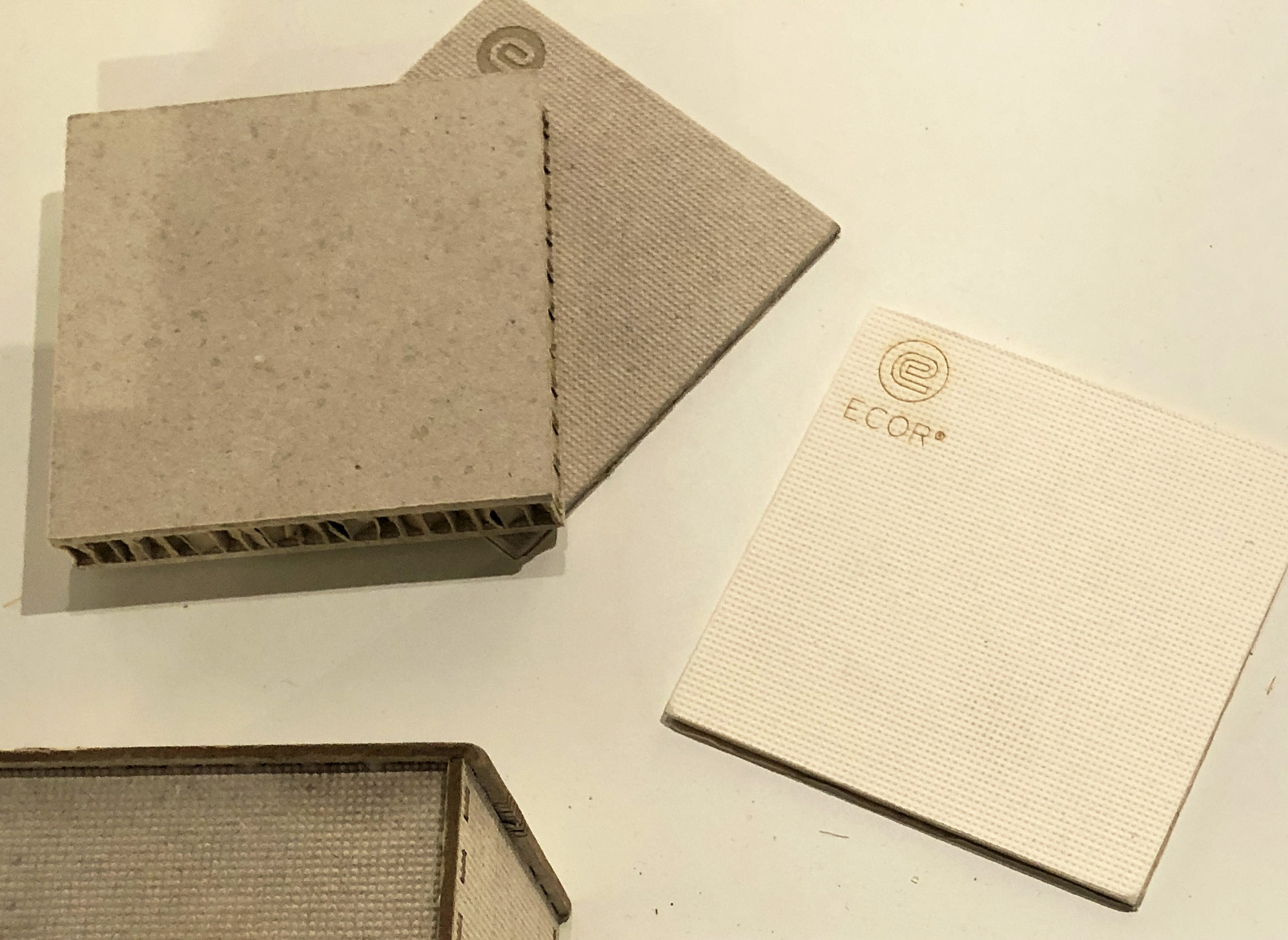 ECOR - This material is made only from waste, water and heat. A combination of old cardboard, newsprint, office waste, and agricultural fibres are used to create 100% recyclable panels for use in interiors, product design and more. This is a much needed solution to the critical waste disposal problems of today.Find out more: www.ecorglobal.com | @ECORglobal