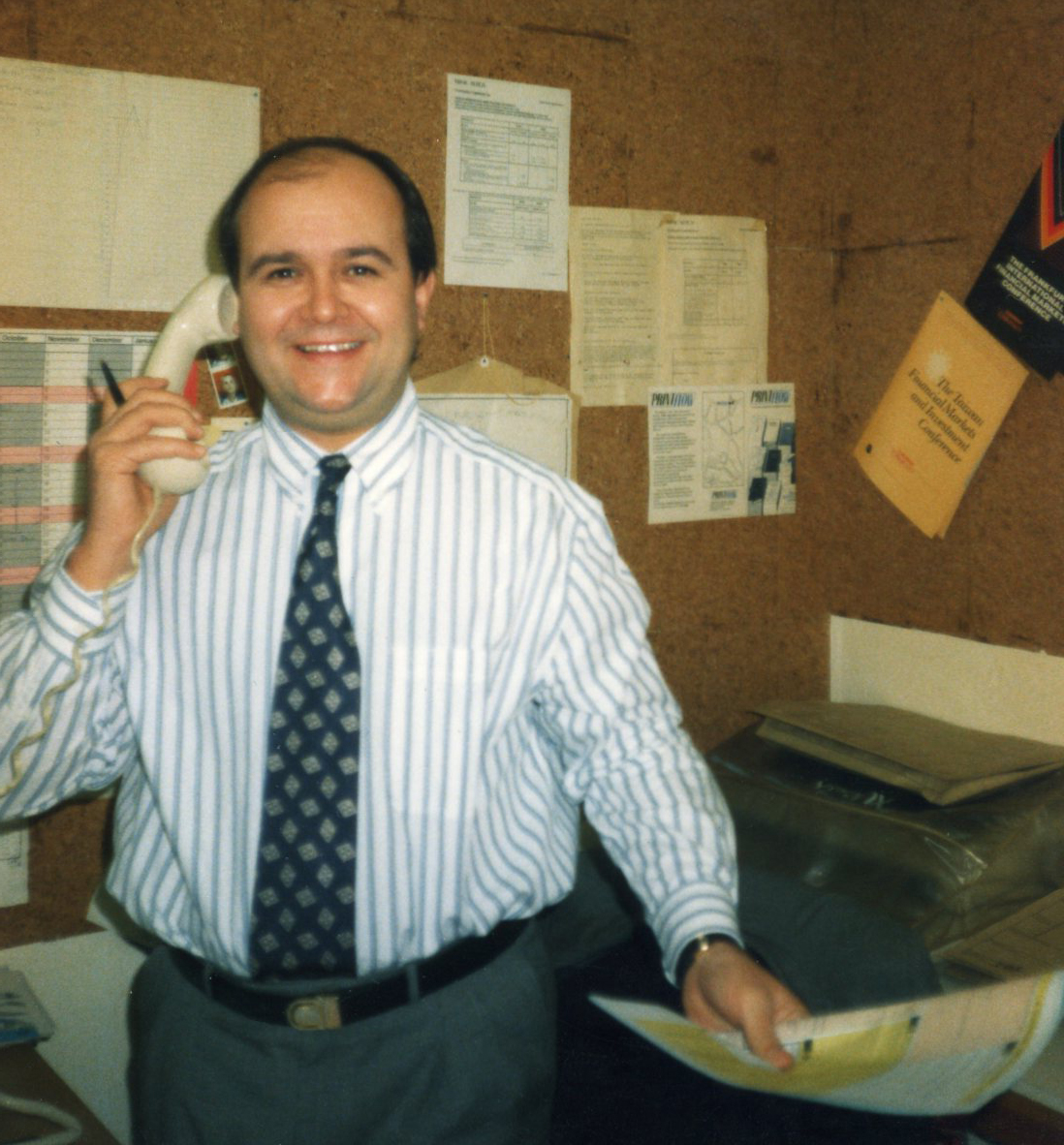 Founder Les Manning taking an order from a customer circa 1987.